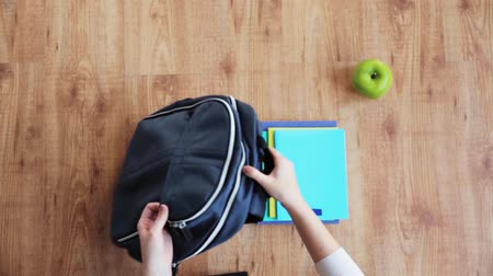 hands packing schoolbag Stock Footage