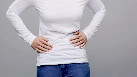 cramps : woman suffering from stomach ache