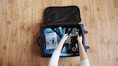 stuff bag : hands packing travel bag with personal stuff Stock Footage