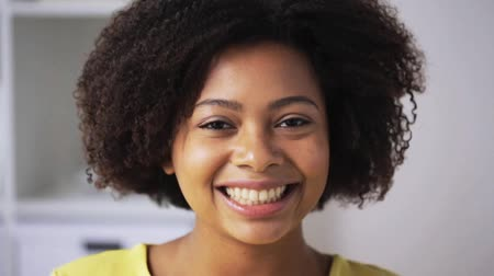 african decent : happy african american young woman face at home