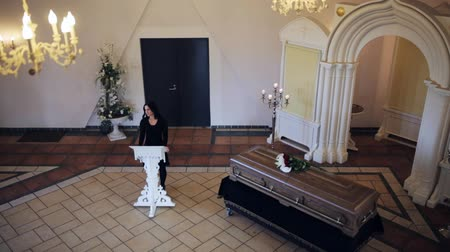 trumna : sad woman and coffin at funeral in orthodox church