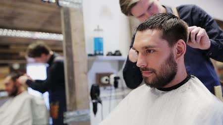 barbear : man and stylist doing haircut at barber shop