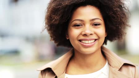 african decent : close up happy african american woman outdoors Stock Footage