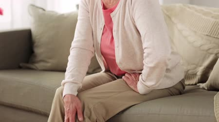 problem : senior woman suffering from pain in leg at home