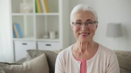 бабушка : portrait of happy senior woman in glasses at home