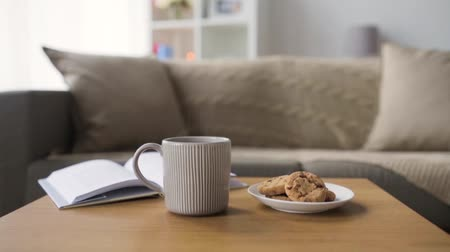 hot beverage : chocolate oatmeal cookies and mug with hot drink Stock Footage