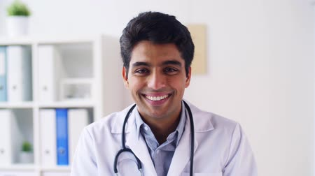 male : portrait of happy smiling young indian male doctor