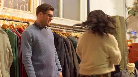 clothing : couple choosing clothes at vintage clothing store Stock Footage