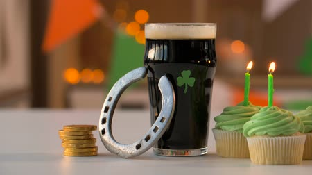 lucky charm : glass of beer, cupcakes, horseshoe and gold coins