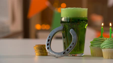 good luck coins : glass of beer, cupcakes, horseshoe and gold coins