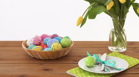desenli : easter eggs in basket and flowers on served table
