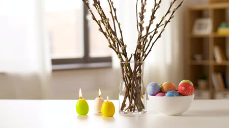 desenli : easter eggs, willow and candles burning at home