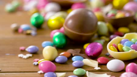 dragee : chocolate easter eggs and drop candies on table Stock Footage