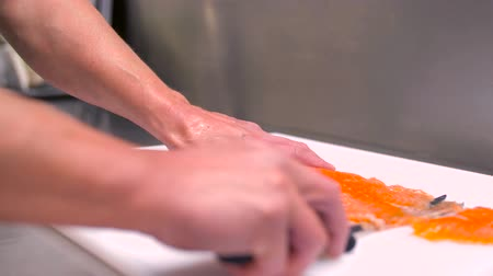 truta : chef slicing smoked salmon fish fillet Stock Footage
