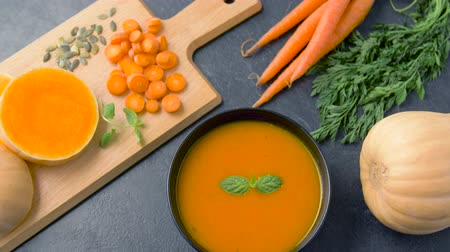 menta : close up of vegetable pumpkin cream soup in bowl