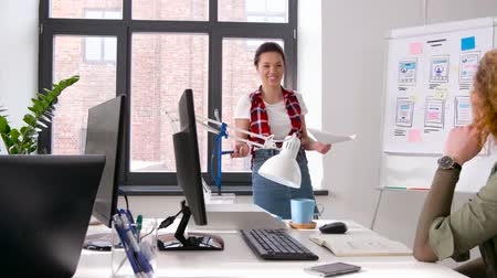 man in office : creative woman at user interface presentation