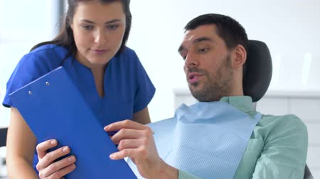 stomatological : dentist and patient discussing dental treatment