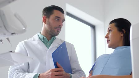 stomatological : dentist and patient talking at dental clinic Stock Footage