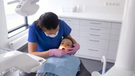 stomatological : dentist checking for kid teeth at dental clinic