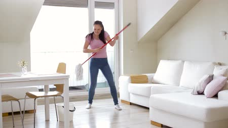 swabber : woman or housewife with mop cleaning floor at home Stock Footage