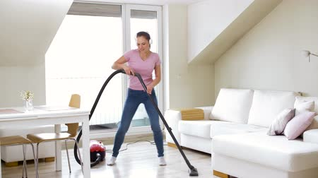 swabber : woman or housewife with vacuum cleaner at home