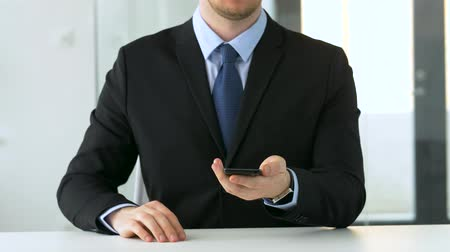 imaginário : businessman working with smartphone at office