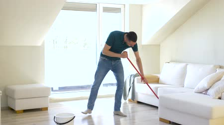 swabber : man with mop cleaning floor at home