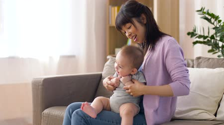 puericultura : happy young mother with little baby boy at home Stock Footage