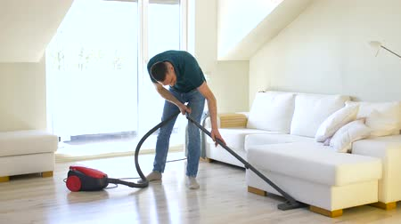 swabber : man with vacuum cleaner at home Stock Footage