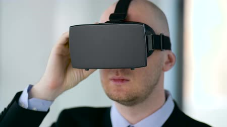 interactive table : businessman with virtual reality headset at office Stock Footage