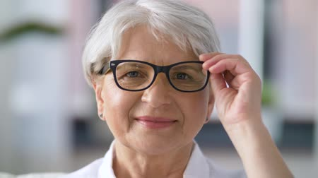 emeryt : portrait of happy senior woman in glasses