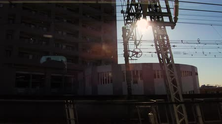 powerline : city view from window of moving train or railway Stock Footage