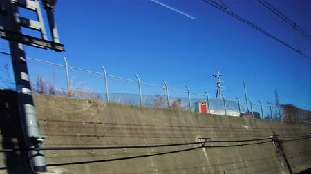 powerline : view to mountains from train or railway in japan