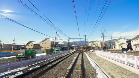 casas : view to suburb from train or railway in japan