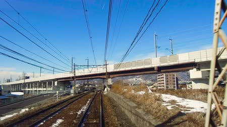 powerline : view to suburb from train or railway in japan
