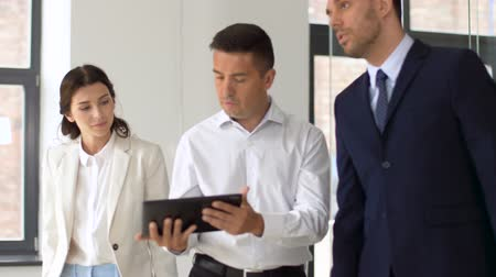 realtor : realtor showing office to customers with tablet pc