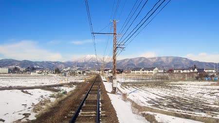 пригородный : view to suburb from train or railway in japan