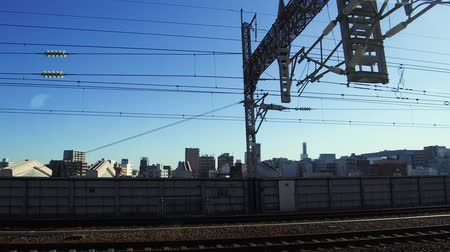 powerline : view to city from moving train or railway in japan Stock Footage