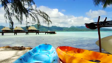 bungaló : kayaks moored on beach in french polynesia