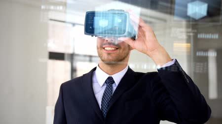 dimension : businessman with vr headset and cube on screen Stock Footage