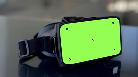 visual effect : vr headset with green screen on table Stock Footage