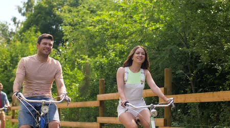 пригородный : happy friends riding fixed gear bicycles in summer