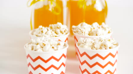 juice jar : lemonade or juice in glass bottles and popcorn Stock Footage