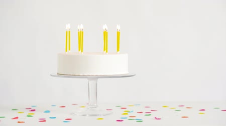 cakes : birthday cake with burning candles on table
