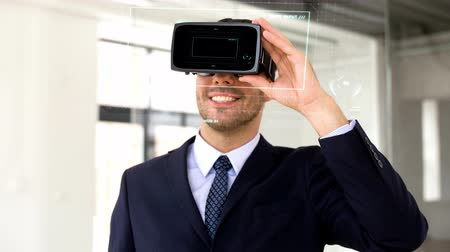 numerical code : businessman with vr headset and score on screen Stock Footage