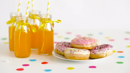 juice jar : donuts and lemonade or juice in glass bottles Stock Footage
