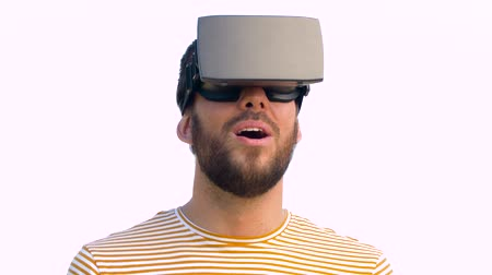 invisible : smiling man in virtual reality headset outdoors