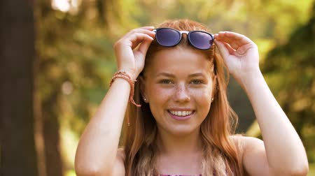 imbir : portrait of redhead teenage girl in summer park