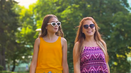 ruivo : teenage girls or friends walking in summer park