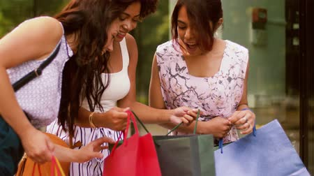 fashion girl : happy women showing shopping bags in city